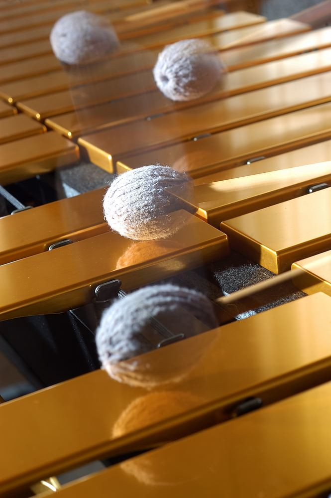photo showing mallets striking vibraphone