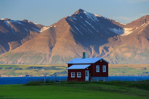 dalvik nordvesturkjordaemi iceland house lone red mountains eyjafjordur sunset warm