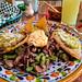 Chalupa, cheese, meat with nopales, tlayoyo, agua de guayaba, and curado de piñón (piñon-flavored pulque), Pulquería la Tía Yola, Tlaxcala por Second-Half Travels