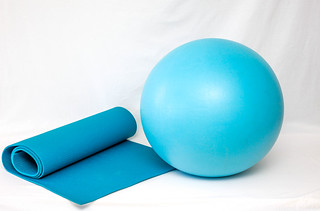 Yoga Mat and Ball on a White Background | by wuestenigel