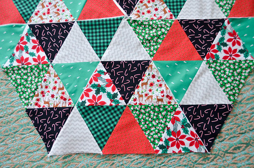 Close-up of flange on equilateral triangle Christmas Tree Skirt quilt