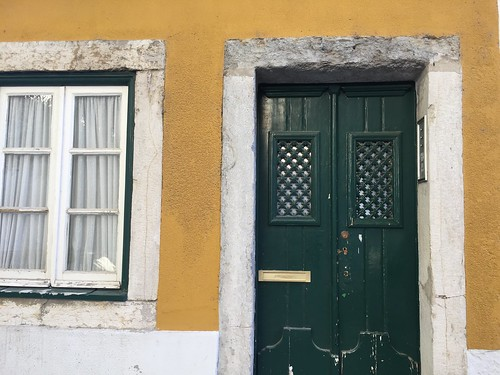 green door on yellow
