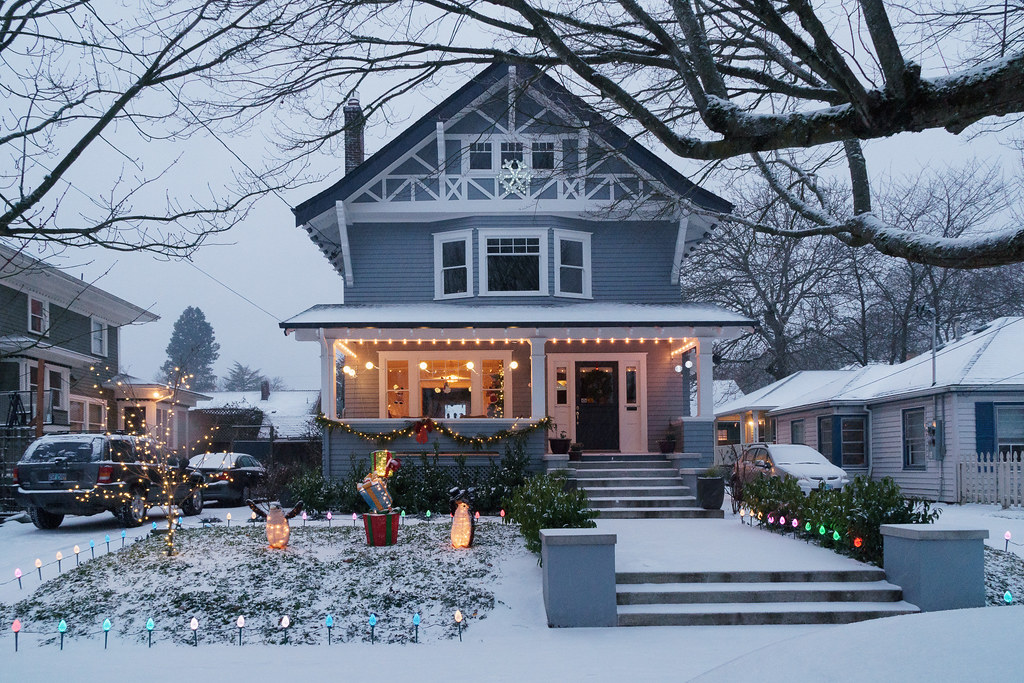 An old house is decorated for Christmas on a snowy Christmas Eve in the Irvington neighborhood of Portland, Oregon