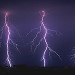 16. Juuli 2003 - 0:00 - After an extremely hot day (temperatures above 35C) in the never ending summer of 2003, I chased night time storms in the province of Flevoland. A line of storms produced a lightning barrage near the city of Lelystad, with many many branched CG's (Cloud-Ground discharges). The three CG's on the photo occured within a second from eachother.  I used Kodachrome-64 slide film with an aperature of f/8 with an exposure of 15 seconds.