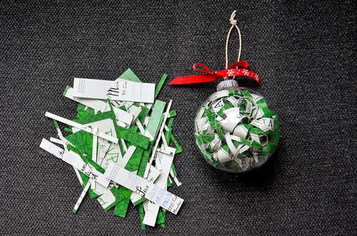 9. Alternative: Fill an ornament bulb with copies of the same invitation (this is about ~8 postcards) - no problem showing names/important dates