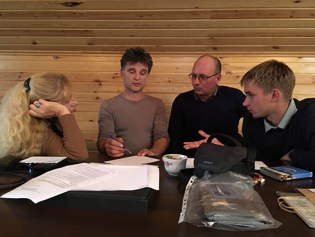 Figure 4. (L-R) Olga Valchuk, Sergei Surmach, Vladimir Pronkevich, and Konstantin Maslovskii during an exercise on study design. Photograph © Jonathan Slaght, WCS.