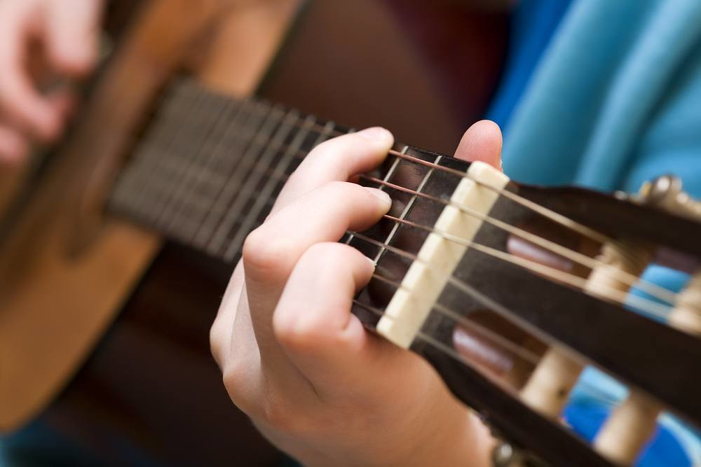 closeup of classical guitarist practicing