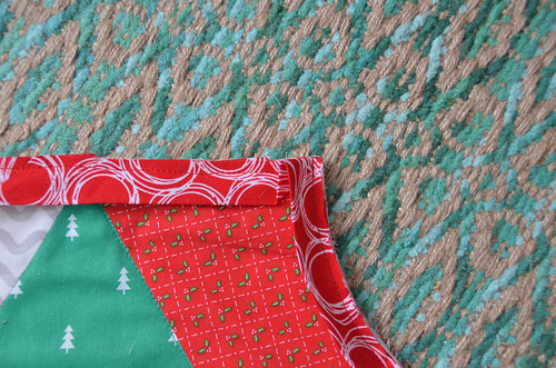 4. Sew fold down, backstitching to the edge and continue sewing until next corner.