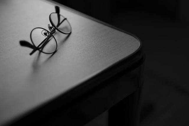 a pair of glasses on the table