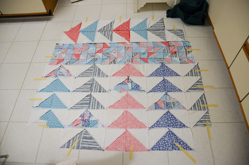10. Quilt sandwich: tape backing down, wrong side up - tug edges smooth before taping