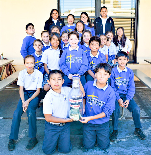 The nativity school 6th graders with the Help us Reach Our Goal Bottle. The Class of 2020 are raising $10,000 for the Sisters of St Louis' mission in Dawhan, Ethiopia