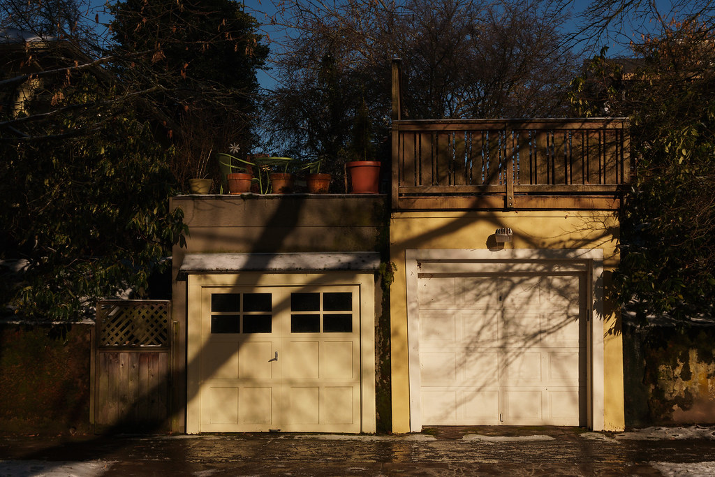A pair of adjacent garages in the Irvington neighborhood of Portland, Oregon on a cold, sunny winter morning
