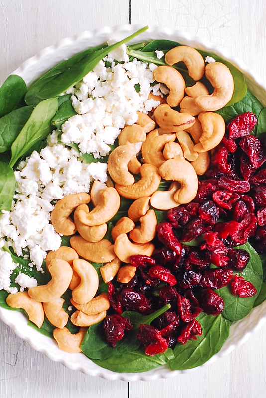 Cranberry Spinach Salad with Cashews and Goat Cheese