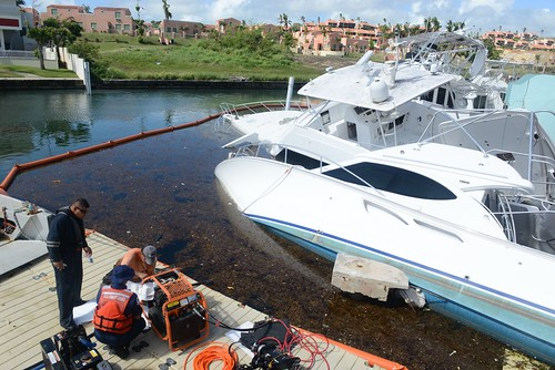 Crews work to dewater storm-impacted vessels in Palmas del Mar, Puerto Rico