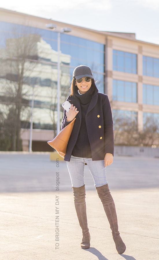 gray wool baseball cap, navy pea coat, striped turtleneck, navy turtleneck sweater tunic, cognac brown tote, lightwash jeans, gray suede over the knee boots
