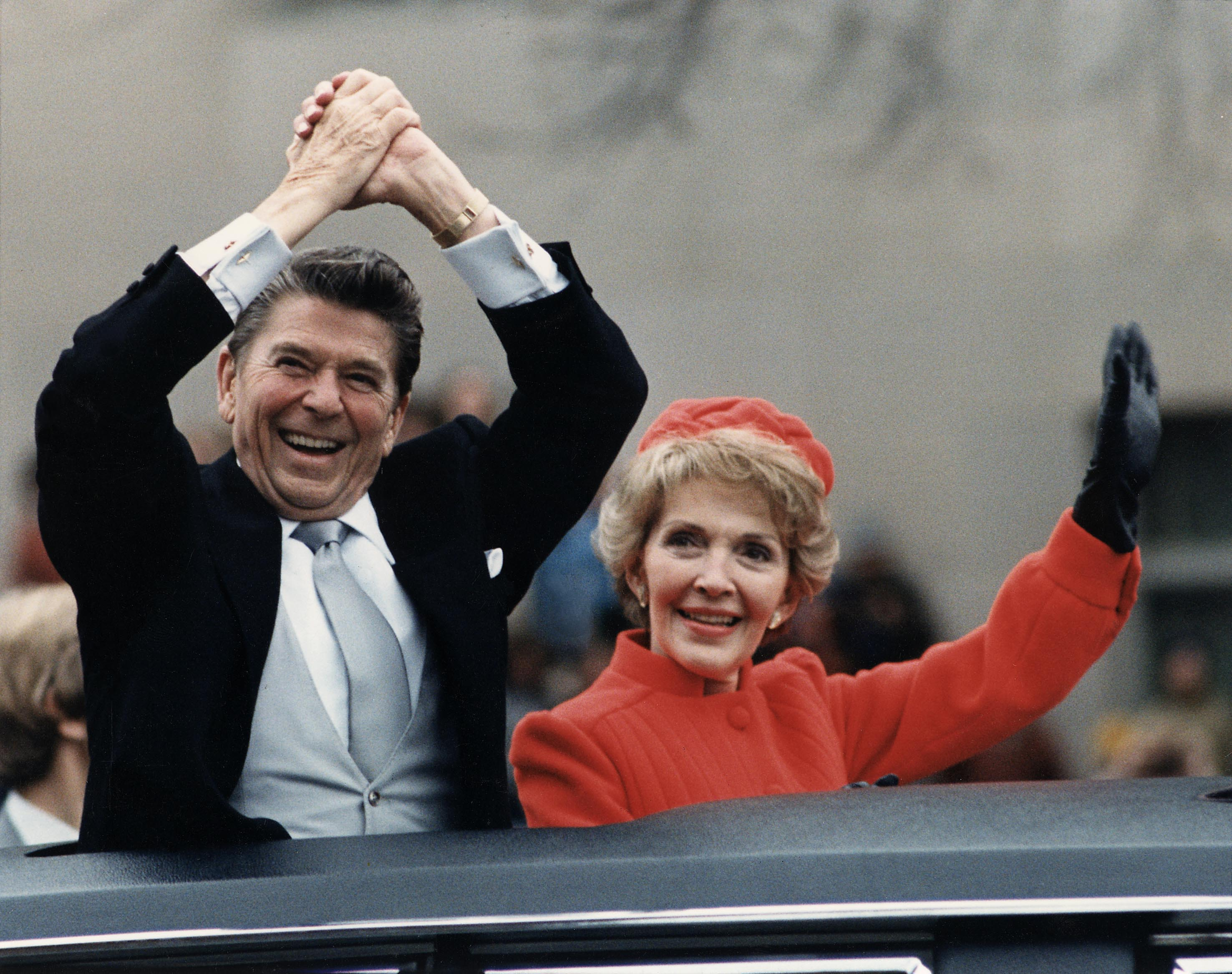 Ronald Reagan and Nancy Reagan waving from the limousine during the Inaugural Parade in Washington, D.C. on Inauguration Day, January 20, 1981.