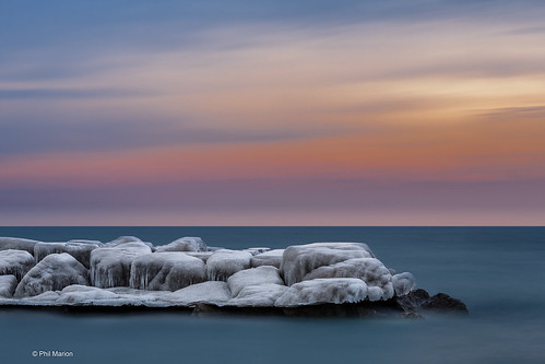 [long exposure] Pastel sunrise over icy Lake Ontario breakwall - Kew Beach, Toronto | by Phil Marion