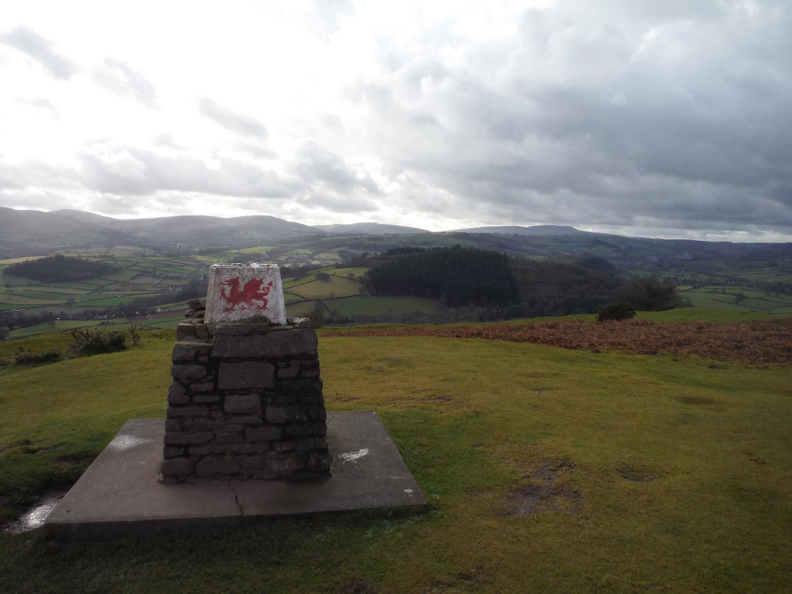 Trig Point, Pen-y-crug, with Black Mountain behind SWC Walk 306 - Brecon Circular (via Y Gaer, Battle and Pen-y-crug)