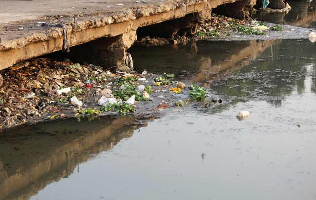 A view of the polluted and waste-laden water as the river flows further into the city at the Siddheshwar ghats.