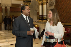 State Rep. Stephanie Cummings talks with Rep. Larry Butler about legislation she proposed to reduce crime in Waterbury.