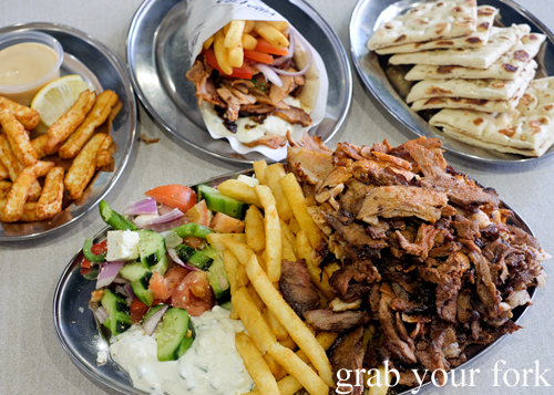 Mixed yeeros plate, haloumi fries, pork belly yeeros and pita bread at Yiro Yiro Greek kebab shop in Belmore