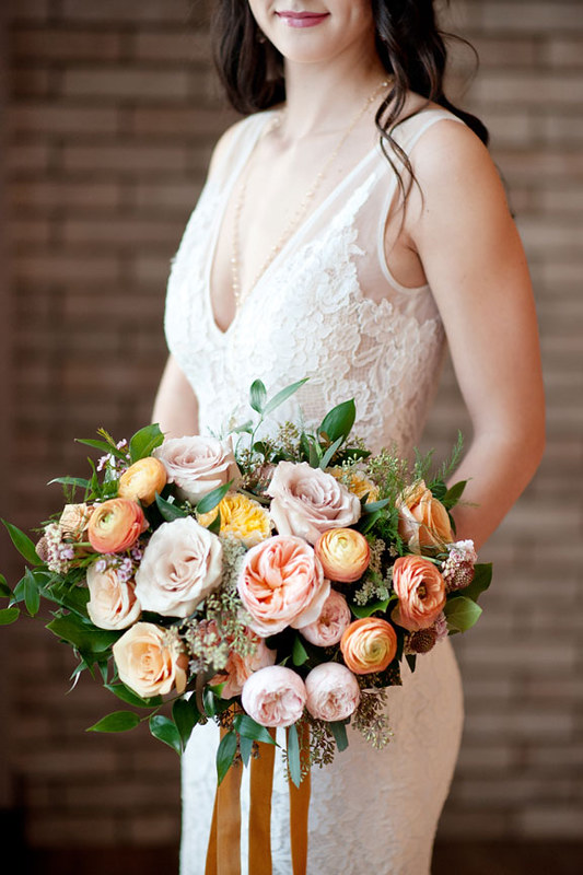 Coral, peach and champagne bridal bouquet with garden rsoes and ranunculus, Flowers by Janie