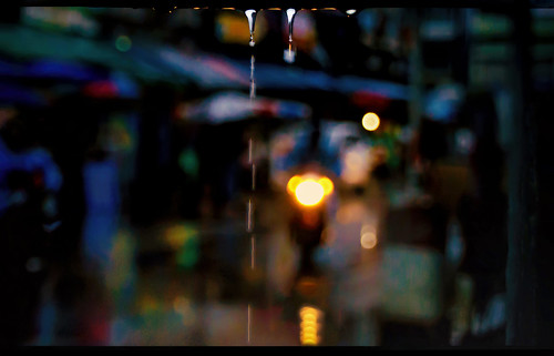 rain rainy market evening dusk night motorcycle motorcyclist cyclist hangdong chiangmaiprovince northernthailand moody wet reflections drops drips headlight backlight pavement awnings retail precipitation weather damp driving riding soaked southeastasia asian thai siam trickle bantawaimarket nikond5100 tamron18270 photoshopbyfehlfarben thanksbinexoxo