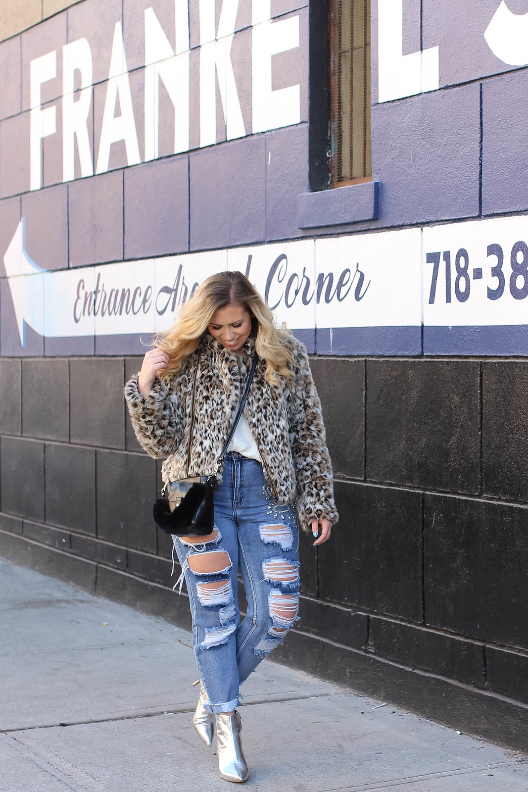 Blonde Curvy Girl Wearing Leopard Faux Fur Coat Distressed Jeans Silver Booties