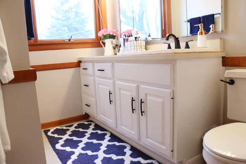 bathroom-vanity-white-cabinets-black-hardware-blue-white-rug-6
