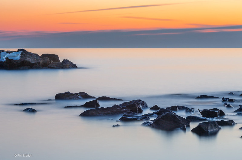 Long exposure of ice capped Lake Ontario breakwall before dawn - Kew Beach, Toronto