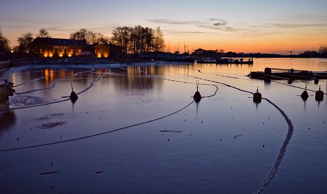 Helsinki. Snowless winter in Finland. Seascape after sunset.