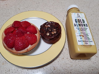 Fruit Flan from Flour of Life; Peanut Butter Cup from Bliss & Co; Golden Milk from Genki Milk Co at Brisbane Vegan Markets