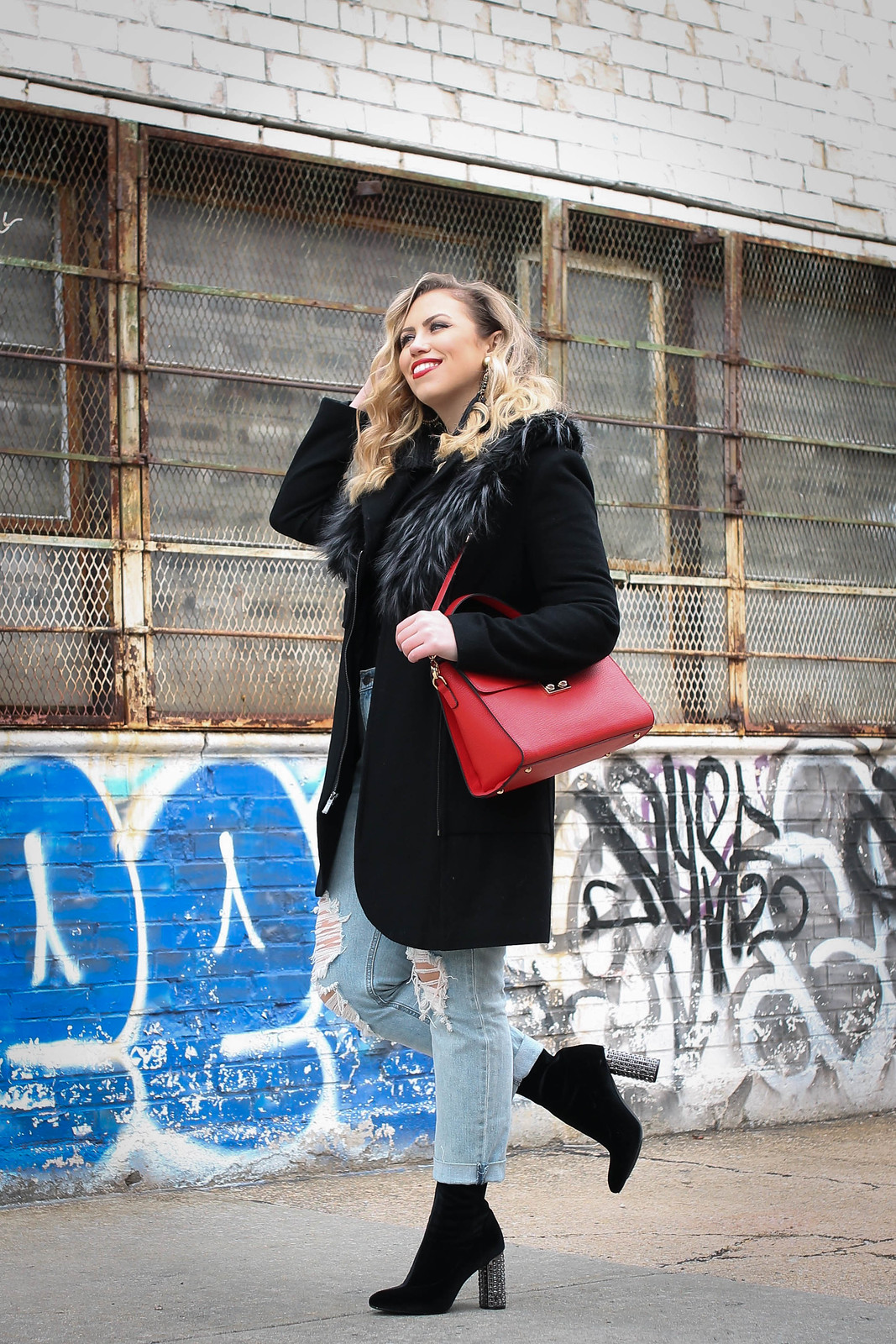 Winter NY Style Black Faux Fur Trim Coat Old Navy Distressed Boyfriend Jeans Red Bag Black Velvet Sock Booties Embellished Block Heels Living After Midnite Jackie Giardina