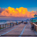 Juno Beach Pier Clouds Light Up at Sunset by Captain Kimo