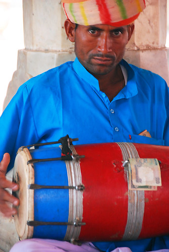 A drummer in the Hawa Mahal, or Palace of Winds, Jaipur, India