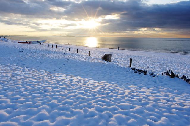 sunrise on the snow beach