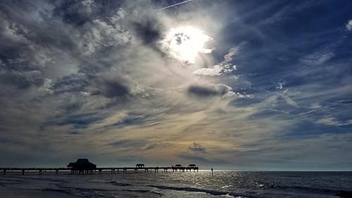 sunset clouds sky pier pier60 clearwaterbeach beach whitesand water gulf ocean florida