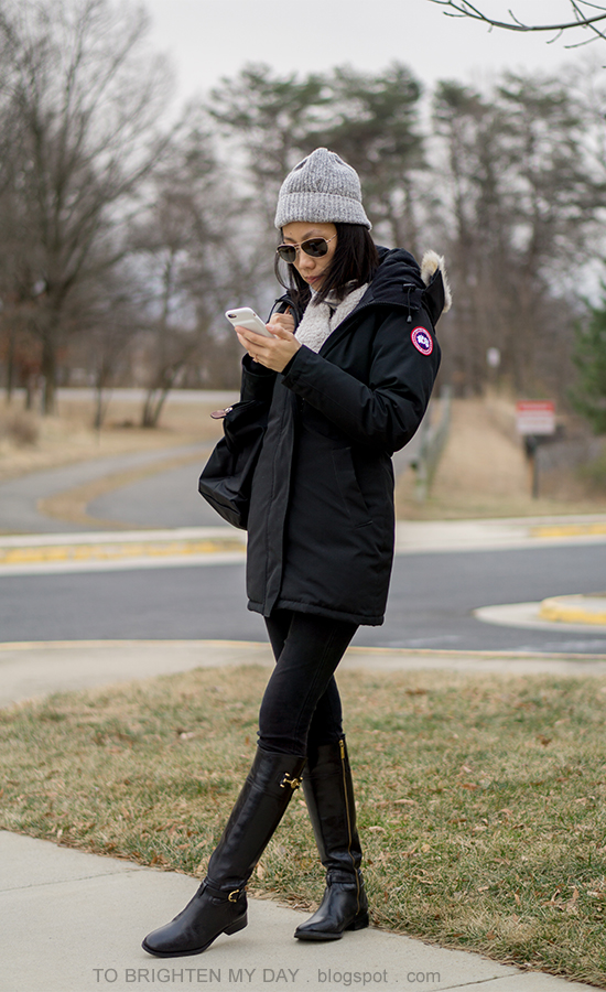 gray beanie, black parka, sherpa cardigan, striped turtleneck, black jeans, black riding boots