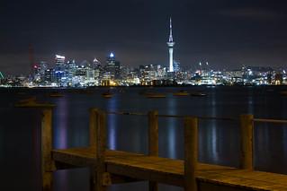 Night city skyline with jetty - Auckland, New Zealand