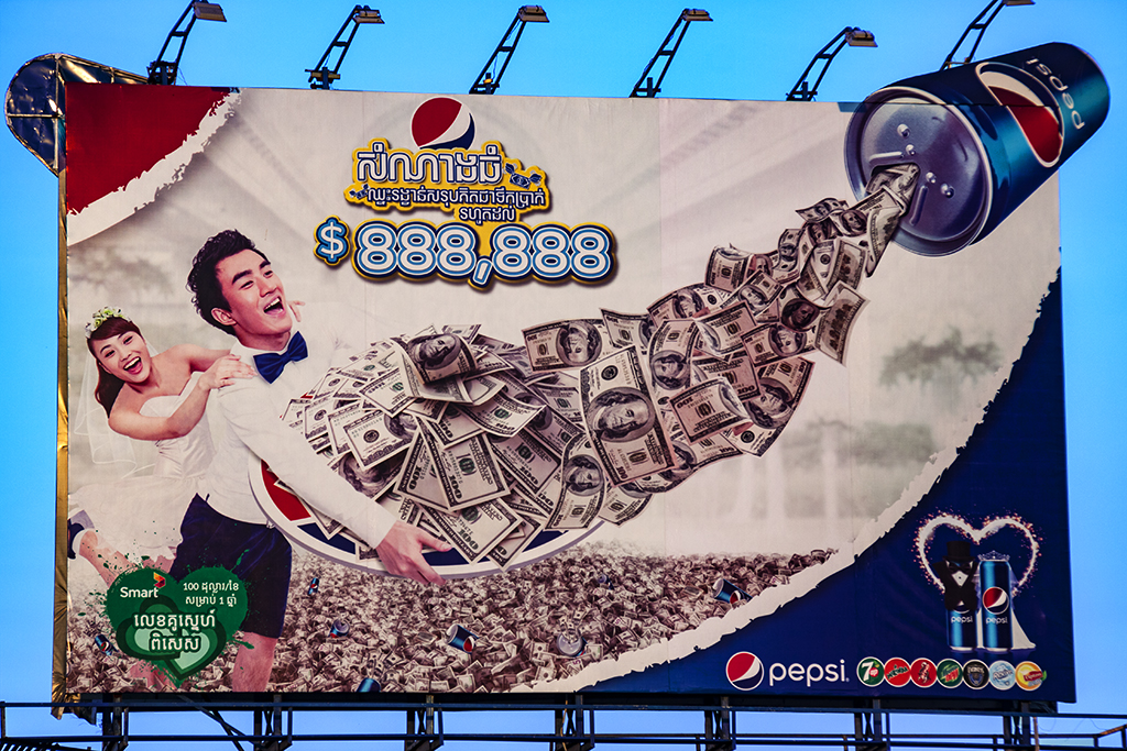 Pepsi can spouting dollars--Phnom Penh