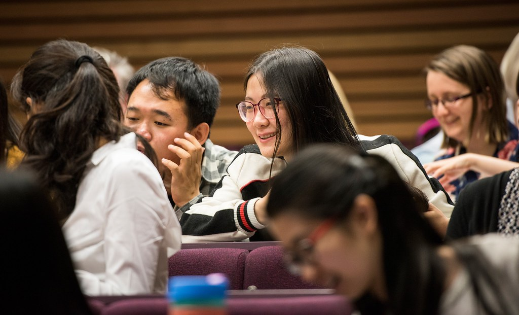 International students discussing a point in a lecture