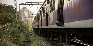 open defecation along mumbai train tracks