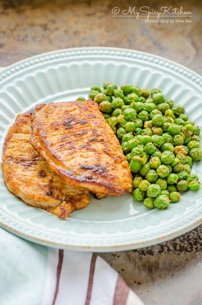 Plated 3 ingredient pork chops with english peas.