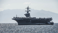 MANILA, Philippines (Feb. 19, 2018) The aircraft carrier USS Carl Vinson (CVN 70) sits anchored off the coast of Manila. Carl Vinson Strike Group is currently in the Western Pacific as part of a regularly scheduled deployment. (U.S. Navy photo by Mass Communication Specialist 3rd Class Dylan M. Kinee/Released)