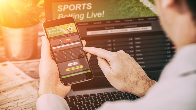 Man uses mobile to place bet on a sports gambling app