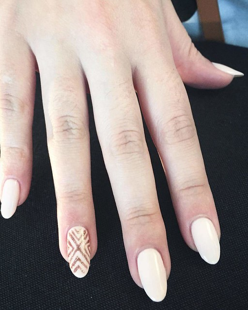 White-and-golden-shimmer-nail-art-for-oval-nails
