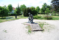 Bench and Garbage Can, and Statue