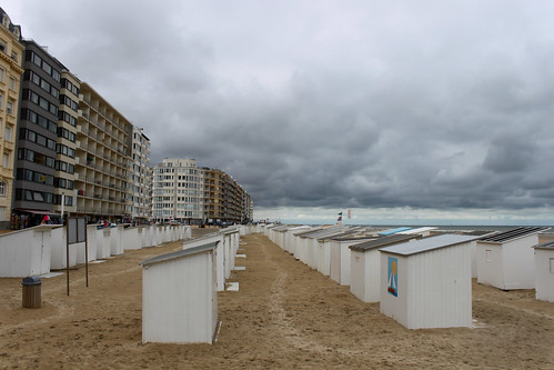 white cabins on beach