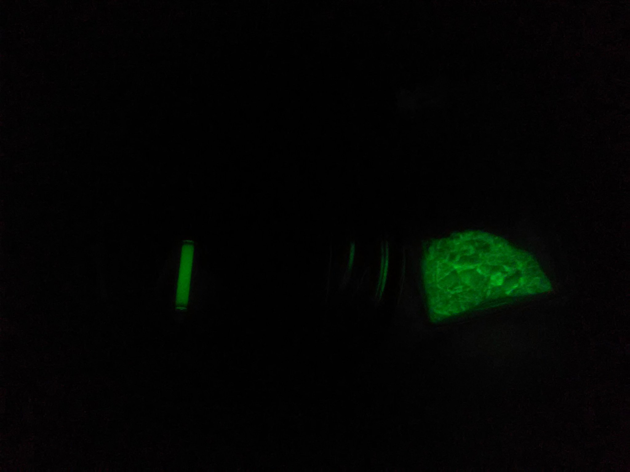Tritium vial left glow powder right