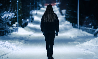 Girl looking down the wintery street